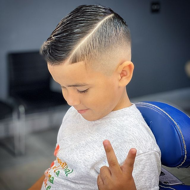 Photo by Miami Barber Yandell Rivera in Yandyblendz Barber Salon. Image may contain: one or more people, child and closeup.