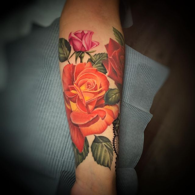 Photo by April Ramirez on March 15, 2021. May be an image of one or more people, tattoo and rose.
