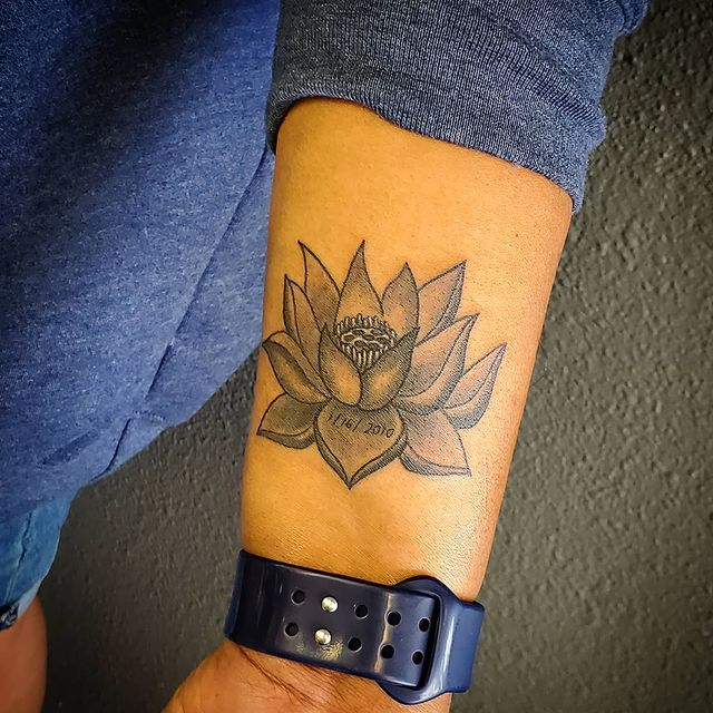 Photo by Johnny Xaysanapannha on March 25, 2021. May be an image of one or more people, tattoo and flower.