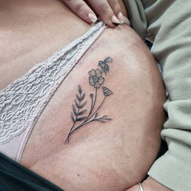 Photo by Boundless Ink in Boundless Ink Tattoo Studio. May be an image of one or more people, tattoo and flower.