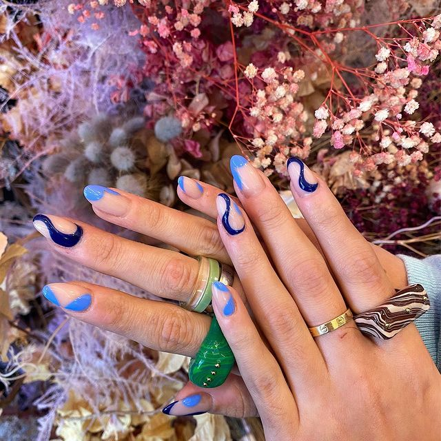 Photo by NAIL COUTURE BEAUTY LOUNGE in Nail Couture Beauty Lounge. May be an image of 1 person, jewelry and flower.